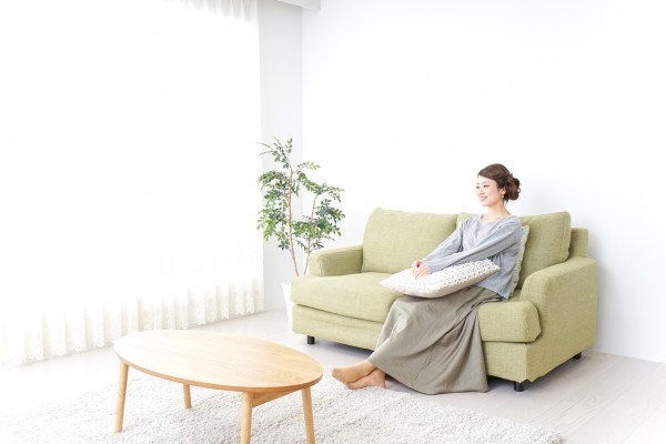 woman watching TV at home
