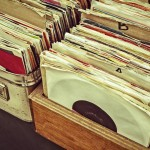 Retro styled image of boxes with vinyl turntable records on a flee market