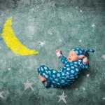 Baby sleeping with the stars