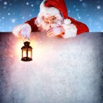 Santa Clause holding Lantern, looking down a empty signboard