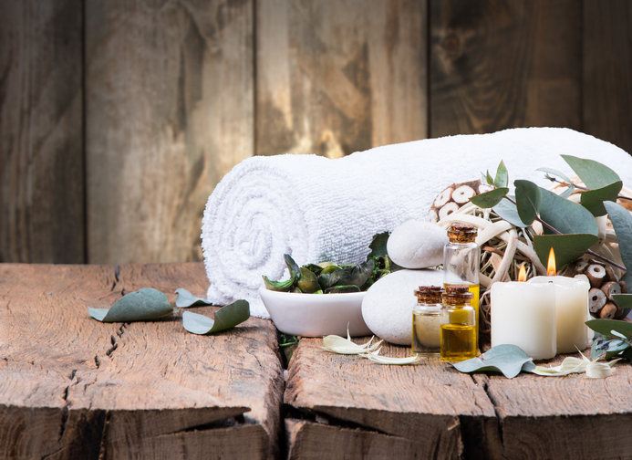 spa massage setting, product, oil on wooden background