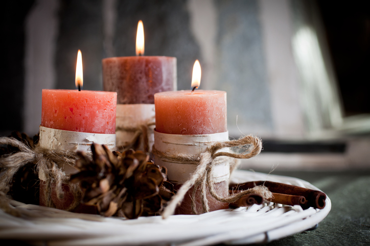 Orange candles with birch decorations