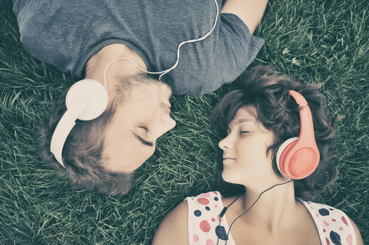 Couple listening to music on headphones
