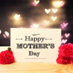 Mothers Day message card with carnation flowers and heart shaped lights